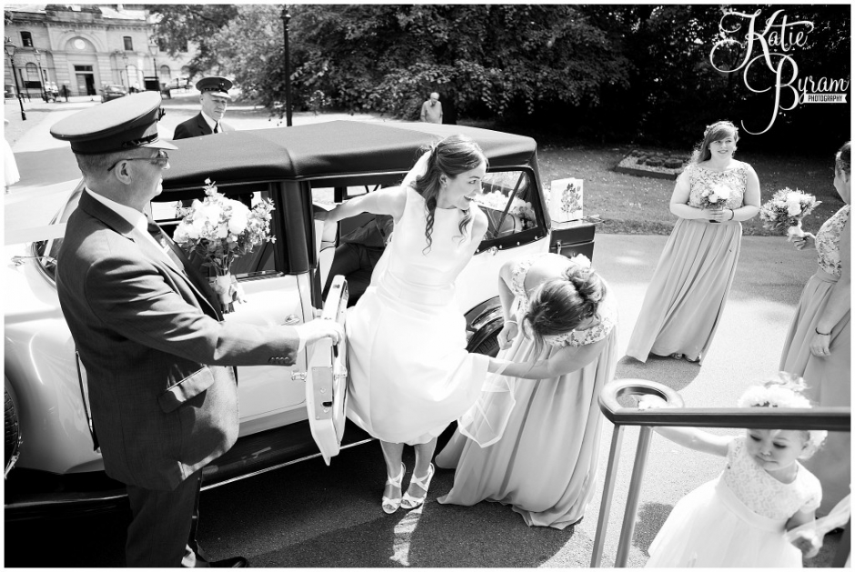 black and white wedding photo, bride getting out of the car, the arches dean clough, yorkshire wedding venue, halifax wedding venue, saltaire wedding, saltaire church, yorkshire wedding photographer
