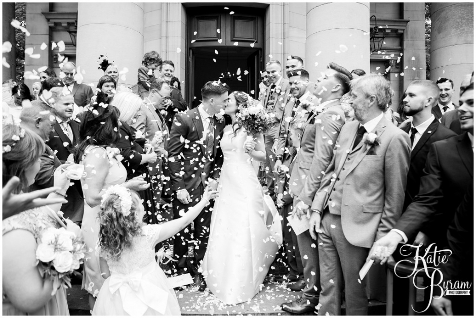 black and white confetti photo, the arches dean clough, yorkshire wedding venue, halifax wedding venue, saltaire wedding, saltaire church, yorkshire wedding photographer
