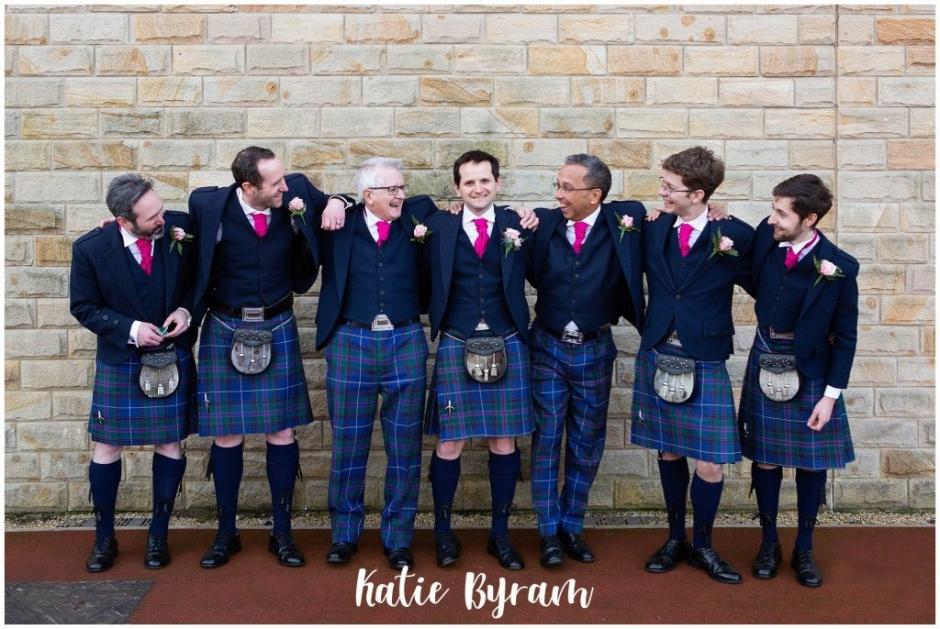 huddersfield wedding photographer, katie byram photography, holy trinity church gateshead, gateshead stadium wedding, bouncy castle wedding